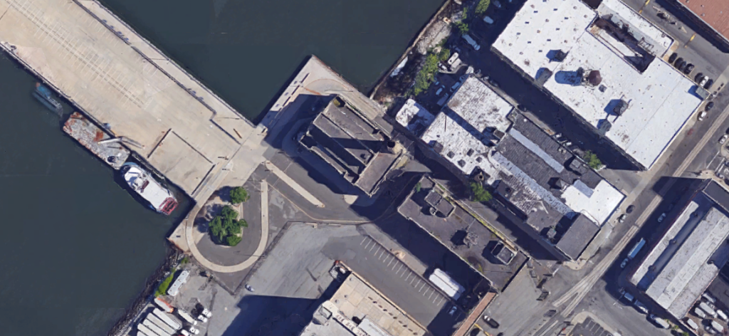 Brooklyn docks. Silent parking lots and factories and loading facilities to the east.